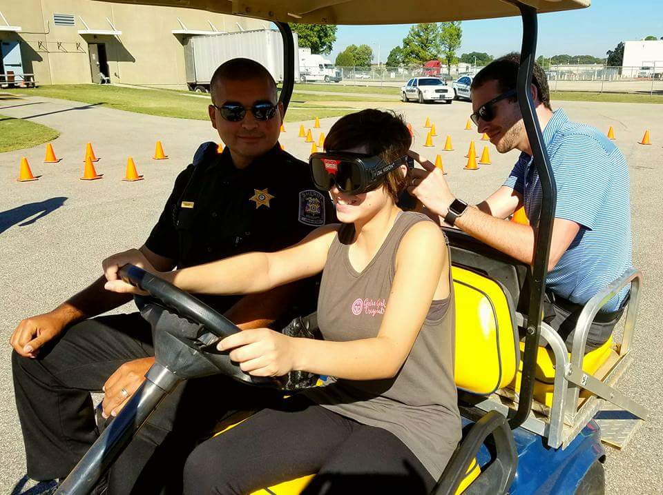 Whiskey Unit Members with Teen Simulating Driving While Intoxicated